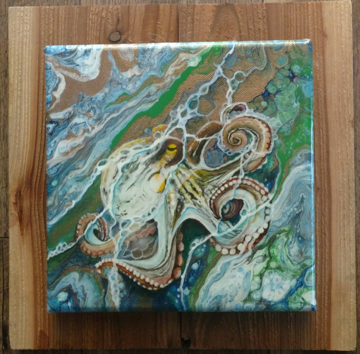 This acrylic pour design was created in layers and then coated with poly acrylic.
